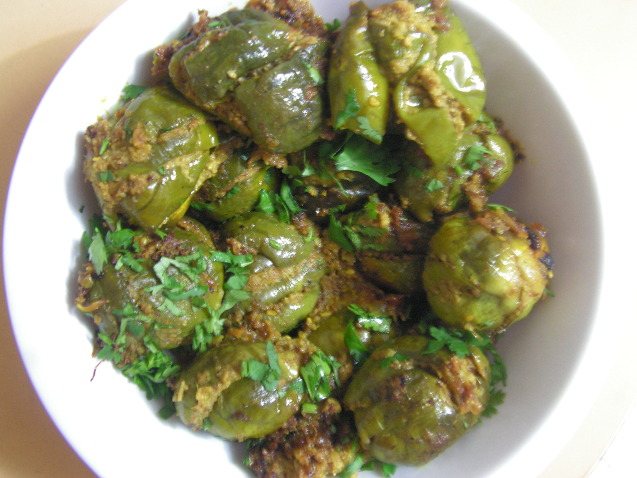 Yengai stuffed eggplant brinjal in northern karnataka style garnished with cilantro forumfinder Images